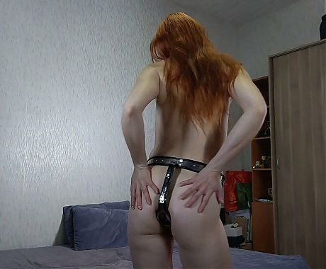 First fitting of a chastity belt by a slavegirl